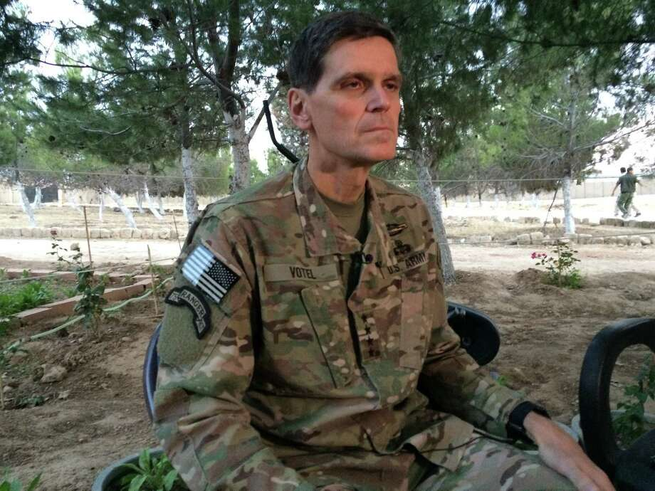 "Army Gen. Joseph Votel speaks to reporters Saturday during a secret trip to Syria. Votel said he is encouraged by progress in building local Syrian Arab and Kurdish forces to fight the Islamic State. He brought reporters with him because he did not ""want people guessing"" about the purpose of his trip. Photo: Robert Burns, STF / AP"