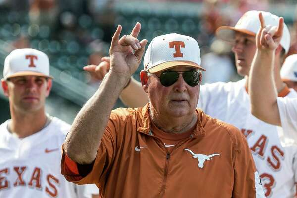 """Texas coach Augie Garrido sings """"The Eyes of Texas"""" with the team after Texas defeated Baylor 7-6 in a college baseball game in Austin, Texas, on Saturday, May 21, 2016. (Rodolfo Gonzalez/Austin American-Statesman via AP)"""