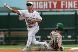 Texas' Jake McKenzie turns a double play as Baylor's Justin Arrington slides into second base during the first inning of an college baseball game in Austin, Texas, on Saturday, May 21, 2016. Texas defeated Baylor 7-6. (Rodolfo Gonzalez/Austin American-Statesman via AP)