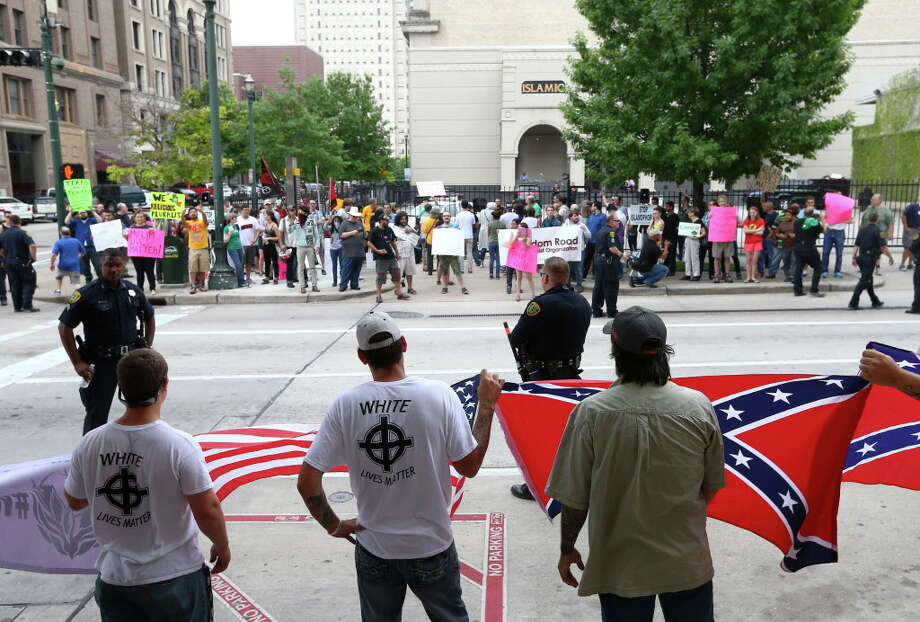 Protesters exchange words in front of the Islamic Da'Wah Center, Saturday, May 21, in Houston. About a dozen people came to protest what they called the threat of radical Islam, and several dozen people counter-protested their actions. Photo: Jon Shapley, Houston Chronicle / © 2015  Houston Chronicle