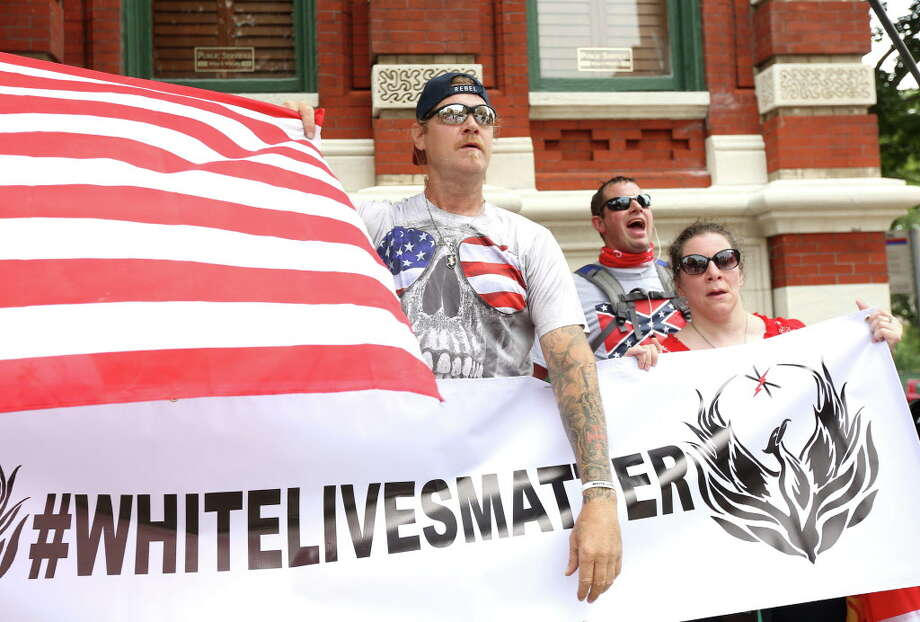 About a dozen people protested against what they called the threat of radical Islam, at the Islamic Da'Wah Center, Saturday, May 21, 2016, in Houston. They were met by several dozen counter-protesters. That protest was later revealed to be organized by Russian trolls.  Photo: Jon Shapley, Houston Chronicle / © 2015  Houston Chronicle