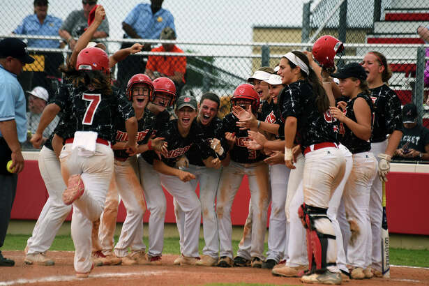 Katy sophomore third baseman Kayla Garcia (7) skips to home plate where her teammates await to celebrate her grand slam in the bottom of the 6th inning against Alvin in game 3 of their Region III-6A semifinal playoff matchup at Katy High School on Saturday. (Photo by Jerry Baker/Freelance)