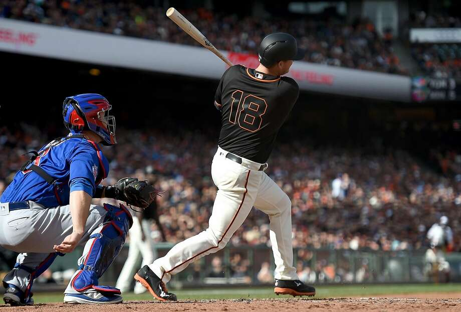 Matt Cain slams a two-run double off Jon Lester in the second inning for the game's first runs. Photo: Thearon W. Henderson, Getty Images
