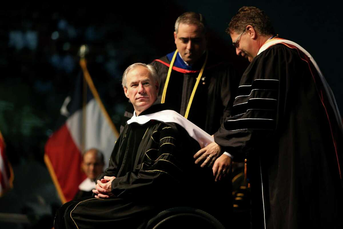 Gov. Greg Abbott is awarded an honorary Doctor of Letters degree at the University of St. Thomas Spring Commencement held at NRG Arena, Saturday, May 21, 2016, in Houston, Texas. Gov. Abbott also delivered the commencement address to graduating students. ( Gary Coronado / Houston Chronicle )