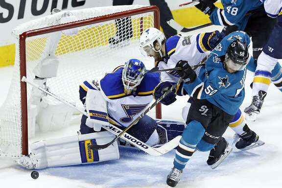 St. Louis Blues' goalie Jake Allen and Kevin Shattenkirk stymie San Jose Sharks' Chris Tierney in 2nd period in Game 4 of NHL Playoffs' Western Conference Finals at SAP Center in San Jose, Calif., on Saturday, May 21, 2016.