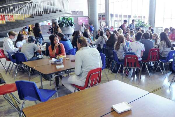 The student center at Greenwich High School is busy, as usual, during lunchtime. Some finance board members want to explore outsourcing the school district's food operations.