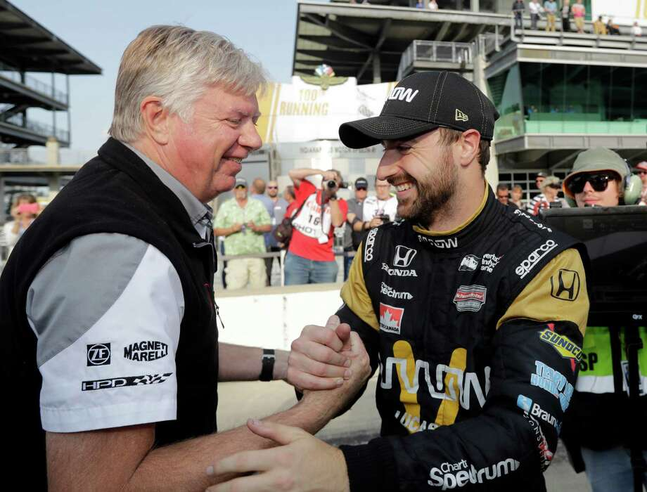 James Hinchcliffe, right, celebrates with a crew member after posting the top four-lap speed during the first day of qualifying for the Indianapolis 500. Photo: Darron Cummings, STF / Copyright 2016 The Associated Press. All rights reserved. This material may not be published, broadcast, rewritten or redistribu
