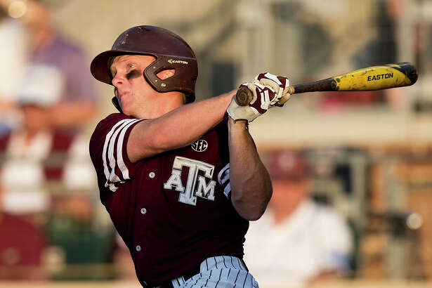 Texas A&M's Boomer White hits a home run off Mississippi pitcher David Parkinson during a college baseball game Friday, May 20, 2016, in College Station, Texas. (Timothy Hurst/Bryan-College Station Eagle via AP)