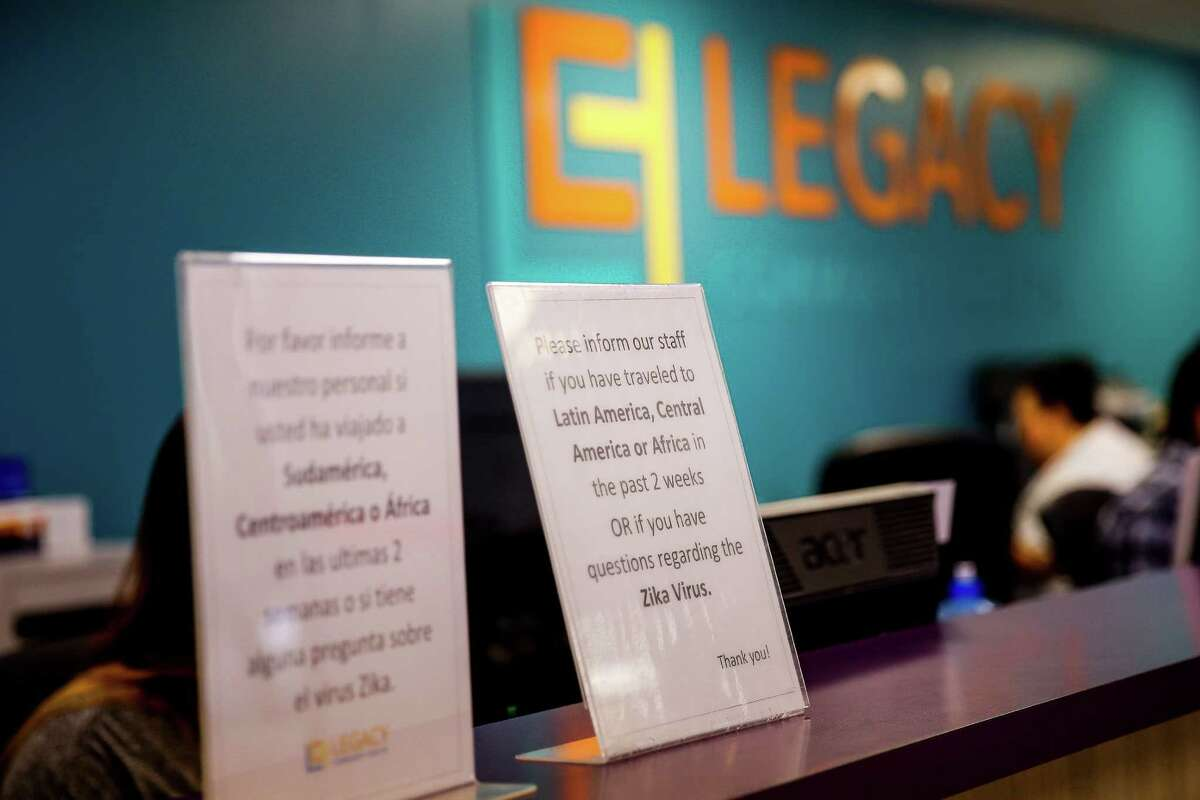 Signs in english and spanish asking about travel to areas with the Zika virus sit in the lobby at Legacy Health Clinic Monday, May 16, 2016 in Houston.
