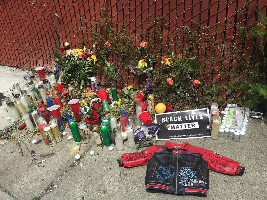 A memorial with candles and flowers marks the spot where Jessica Williams, 29, was shot by a Bayview station sergeant Thursday night. Photo: Kimberly Veklerov