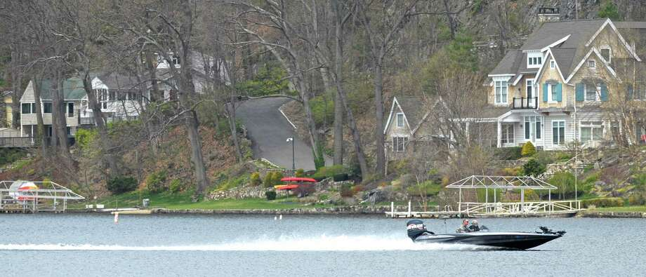 A fishing boat cuts across  Candlewood Lake on Friday, April 22, 2016, in Danbury, Conn, off of Candlewood Park. Photo: H John Voorhees III / Hearst Connecticut Media / The News-Times