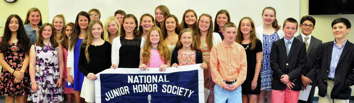 """Seventh-grade students at St. Thomas Aquinas School were recently inducted into National Junior Honor Society, which the school said required them to """"demonstrate scholarship, service, leadership, character and citizenship while holding a 90 percent average in all academic subjects since the sixth grade."""" They are, front row, from left: Isadora Siguenza, Maeve McClure, Grace Furlong, Erin McHugh, Mia Parkes, Eleanor O?'Mahony, Brady Beiser, Clare McCurley, Katherine Backus, Christina Nardone, Caleigh Peloso, Anna Paulmann, Jack Travers, Emma Prince, Finn Day and Jacob Strazza; back row: Scarlett Rollins, Teaghan Doyle, Patrick Galusha, John Patrick Banks, Caitlin May, Ava Golden, Maeve Mallow, Lauren Herley and Sebastian Machado."""