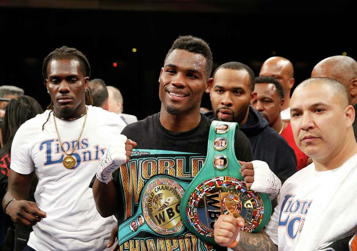 LAS VEGAS, NV - MAY 21: Super welterweight boxer Jermell Charlo poses with members of his camp after beating John Jackson to win the vacant WBC title at The Chelsea at The Cosmopolitan of Las Vegas on May 21, 2016 in Las Vegas, Nevada.