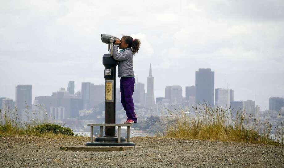 Kayla LaMarche, 7, takes in the view from Angel Island as the Outdoor Afro group stops for lunch. Outdoor Afro's mission is to reconnect African Americans with the outdoors. Photo: Michael Macor, The Chronicle