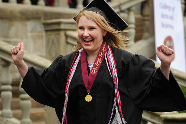 Fairfield University Valedictorian Molly McCarty Gregory gestures to fellow graduates after delivering her address at the Fairfield University graduation in Fairfield, Conn. on Sunday, May 22, 2016.