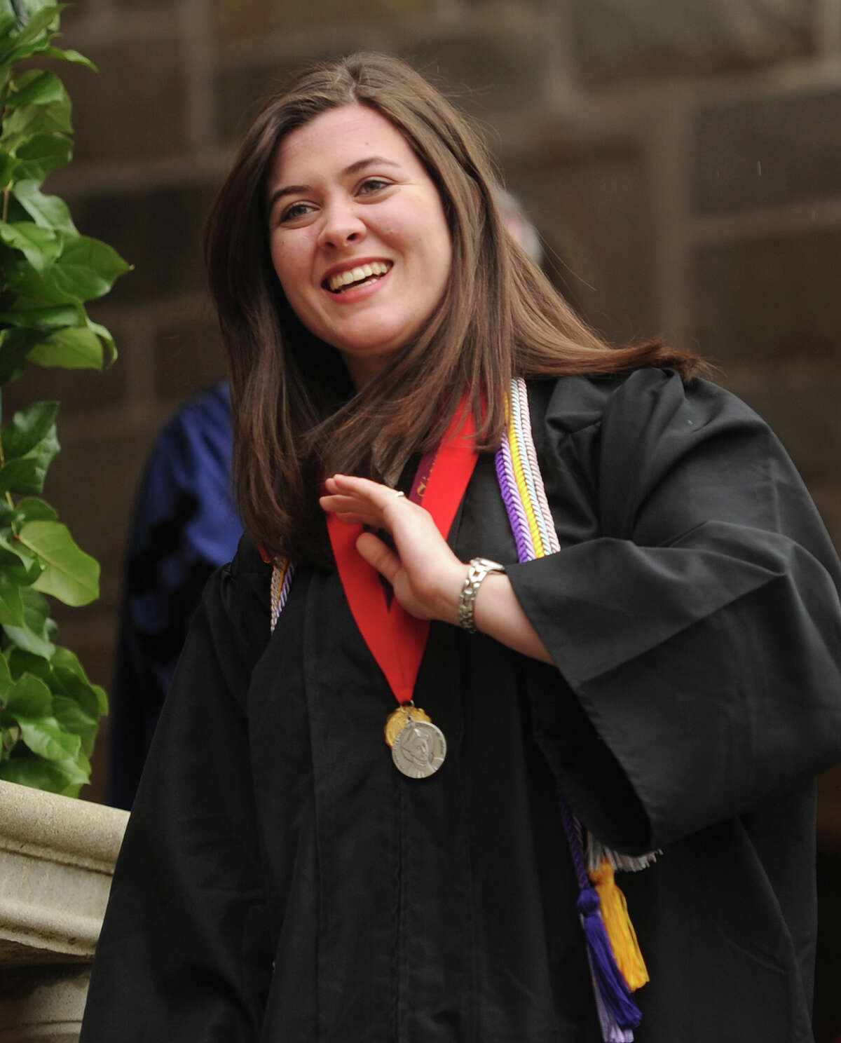 Graduate Jacqueline Aquino smiles after receiving the Saint Ignatius Loyola Medal Award for Outstanding University Service at the Fairfield University graduation in Fairfield, Conn. on Sunday, May 22, 2016.