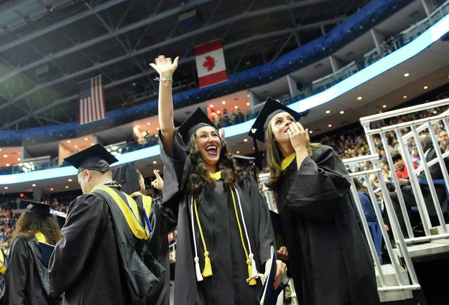Karla Sansone, left, of Stratford, and Carinne Cort-Real, of Danbury, look to the audience during the Western Connecticut State University commencement ceremony at Webster Bank Arena in Bridgeport, Conn. Sunday, May 22, 2016. More than 800 of the university's 1,235 eligible undergraduate candidates participated in the ceremony, along with more than 60 graduate candidates. Photo: Tyler Sizemore / Hearst Connecticut Media / Greenwich Time