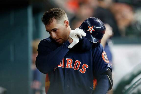 Houston Astros right fielder George Springer (4) throws his batting helmet in the dugout after striking out during the first inning of an MLB baseball game at Minute Maid Park, Sunday, May 22, 2016.