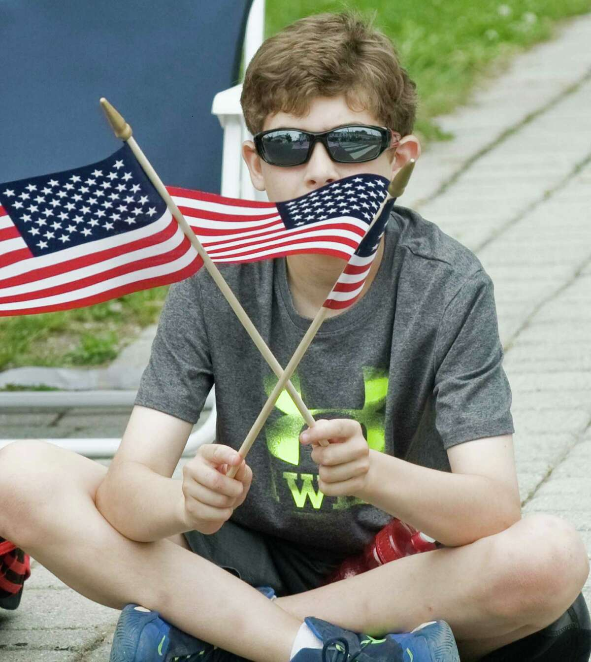 Nicholas Saccomani, 10 of Bethel, with a pair of flags to wave at the Bethel Memorial Day Parade on Greenwood Avenue. Sunday, May 22, 2016