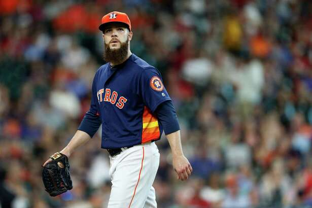Houston Astros starting pitcher Dallas Keuchel (60) walks back to the dugout after pitching during the fourth inning of an MLB baseball game at Minute Maid Park, Sunday, May 22, 2016.