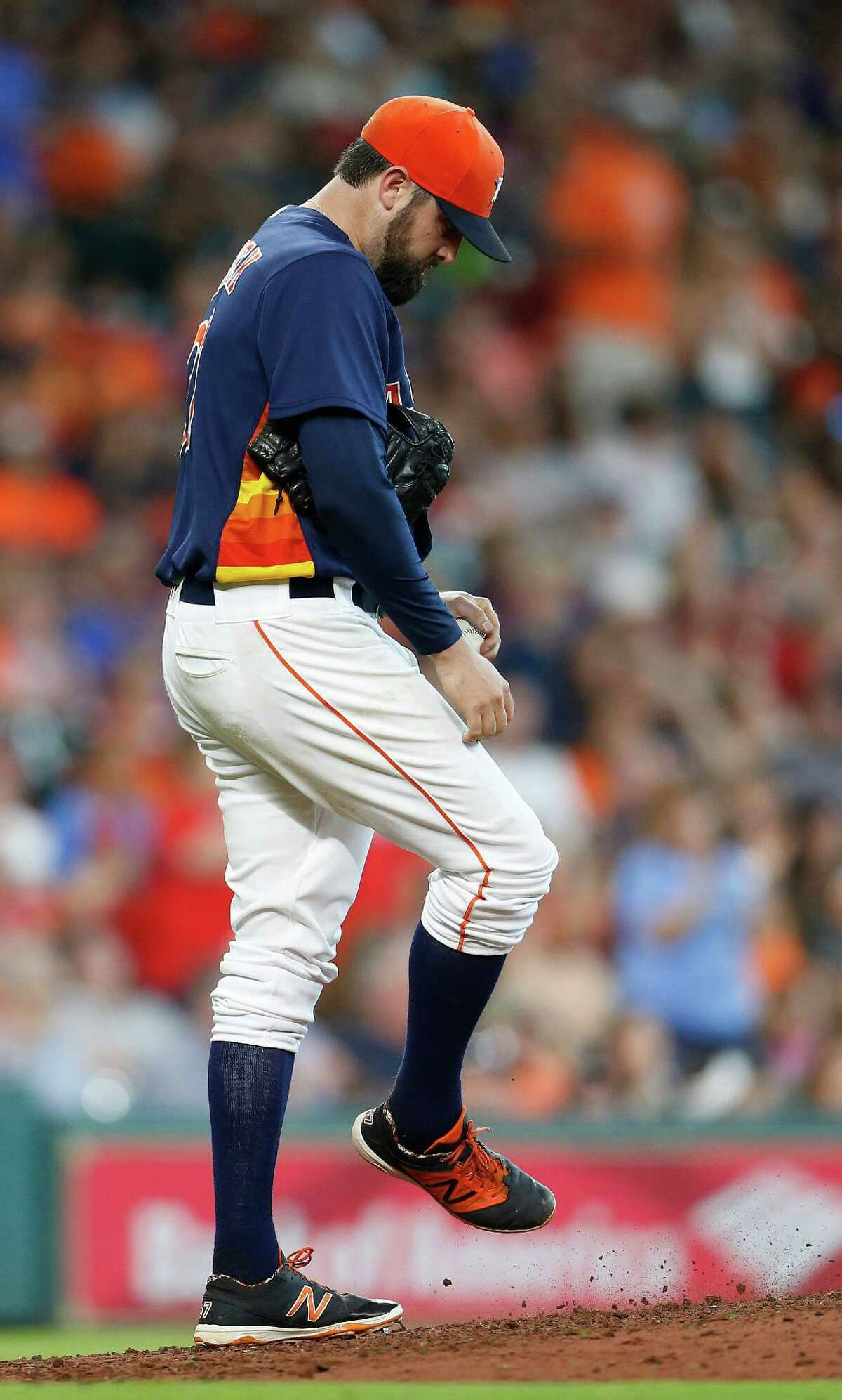 Houston Astros relief pitcher Will Harris (36) reacts after giving up a two-run home run to Texas Rangers Nomar Mazara (30) during the seventh inning of an MLB baseball game at Minute Maid Park, Sunday, May 22, 2016.