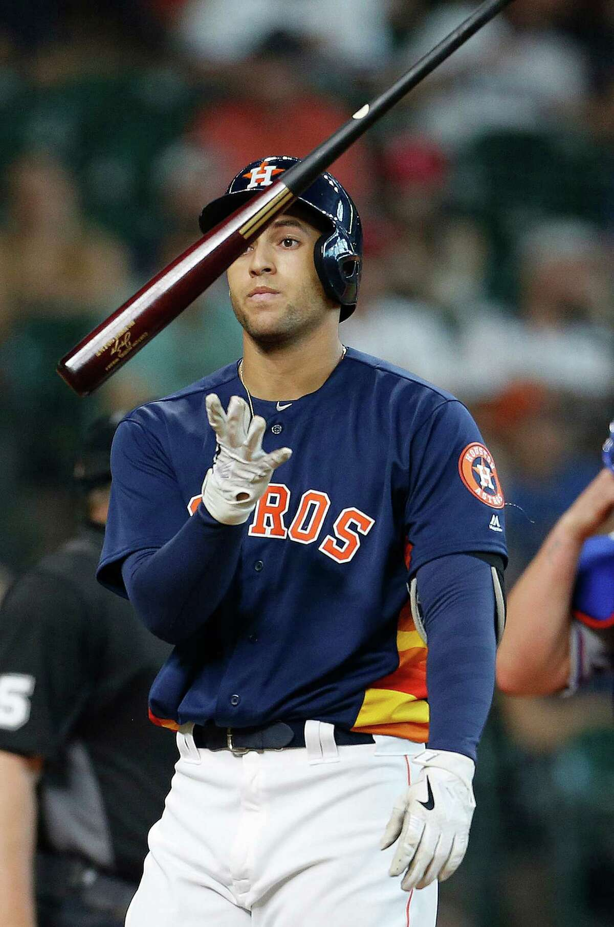 Houston Astros right fielder George Springer (4) reacts after striking out during the eighth inning of an MLB baseball game at Minute Maid Park, Sunday, May 22, 2016.