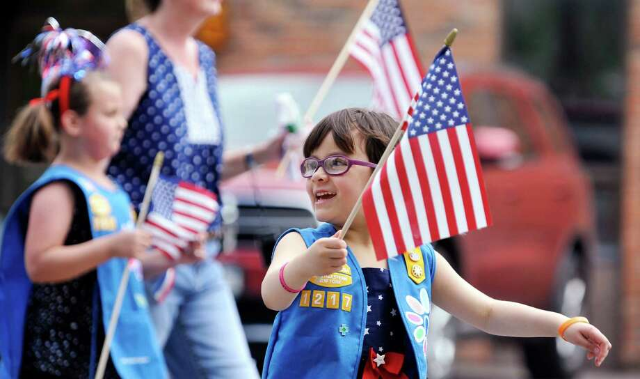 Timothea Tarantelli, 6, a member of the Guilderland Daisy Troop 1217, marches in the Altamont Memorial Day Parade on Sunday, May 22, 2016, in Altamont, N.Y.  (Paul Buckowski / Times Union) Photo: PAUL BUCKOWSKI / 40036617A