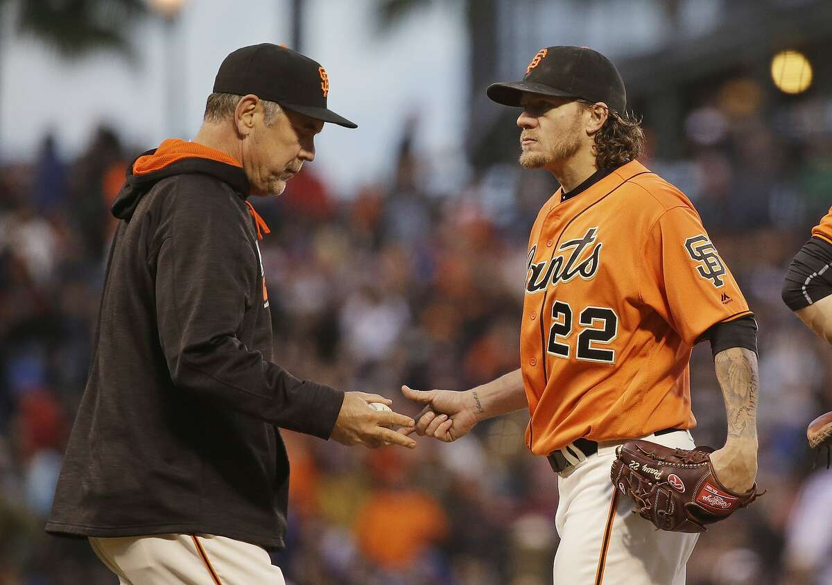 San Francisco Giants manager Bruce Bochy, left, takes the ball from starting pitcher Jake Peavy while removing him during the second inning of a baseball game against the Chicago Cubs on Friday, May 20, 2016, in San Francisco. (AP Photo/Eric Risberg)