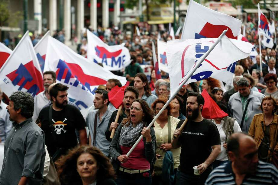 Supporters of the communist-affiliated union PAME chant slogans on Sunday during an anti-austerity rally in Athens, Greece. Demonstrators are voicing their exasperation at yet another round of austerity measures. Photo: Yorgos Karahalis, STR / Copyright 2016 The Associated Press. All rights reserved. This material may not be published, broadcast, rewritten or redistribu