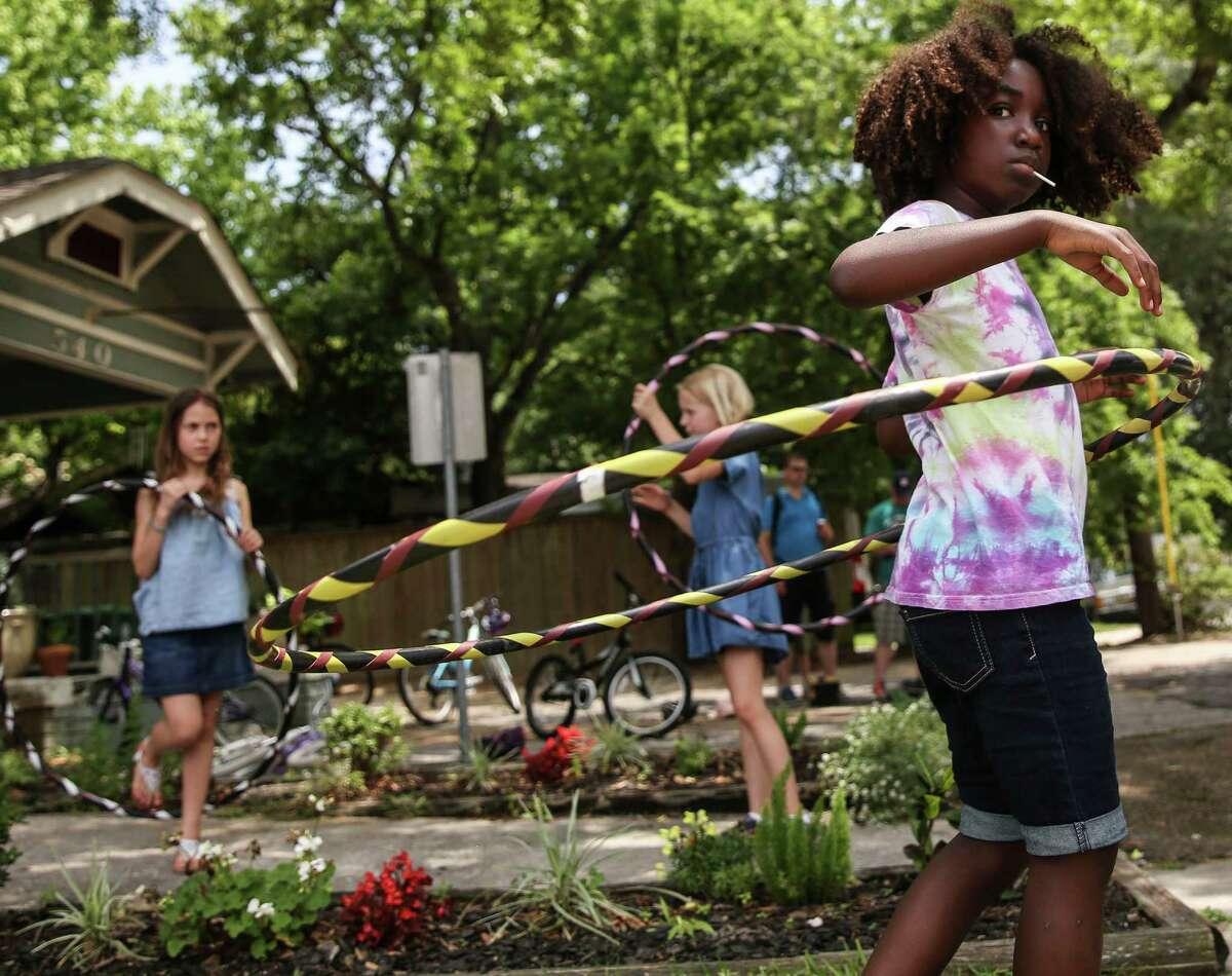 Lotus Wagner, 8, of Houston hula hoops during Cigna Street Sundays on Sunday, May 22, 2016, on White Oak in Houston.