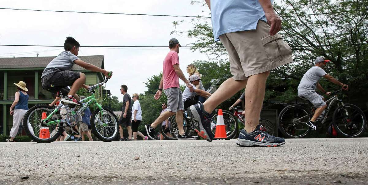 Bicyclists and walkers fill White Oak Drive while it's closed to vehicles during Cigna Street Sundays on Sunday, May 22, 2016, on White Oak in Houston.
