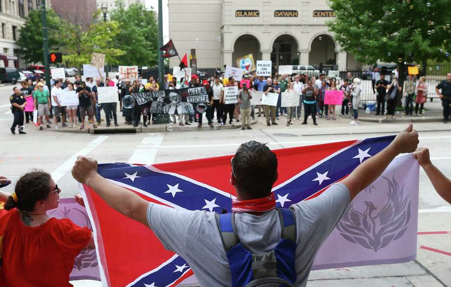 About a dozen people protested against what they called the threat of radical Islam, at the Islamic Da'Wah Center, Saturday, May 21. They were met by several dozen counter-protesters. Photo: Jon Shapley, Houston Chronicle / © 2015  Houston Chronicle