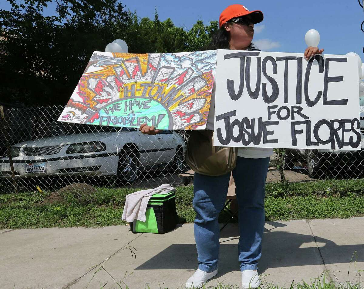 """Priscilla Gonzales displays signs in support of Josué Flores across from a memorial for the 11-year-old, who was stabbed to death. She doesn't live in the neighborhood but drives along Fulton Street often. """"This is the least I can do,"""" she says."""