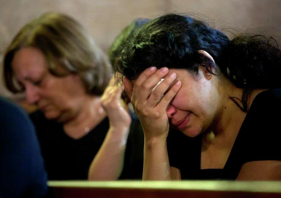 "Coptic Christians grieve during prayers for the departed, remembering the victims of EgyptAir flight 804 at Al-Boutrossiya Church, at the main Coptic Cathedral complex, in Cairo, Egypt, Sunday, May 22, 2016. Making his first public comments since the crash of the Airbus A320 while en route from Paris to Cairo, Egyptian President Abdel-Fattah el-Sissi said Sunday it ""will take time"" to determine the exact cause of the crash, which killed all 66 people on board. (AP Photo/Amr Nabil) Photo: Amr Nabil, STF / Copyright 2016 The Associated Press. All rights reserved. This material may not be published, broadcast, rewritten or redistribu"