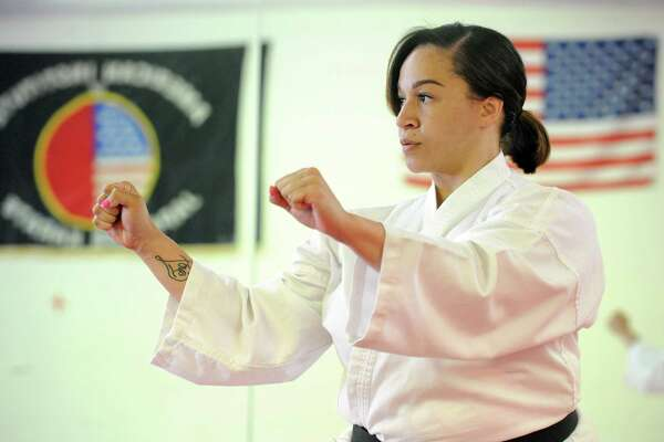 Third degree Karate black belt Kristen Dawson on Tuesday May 10, 2016 in Menands , N.Y. (Michael P. Farrell/Times Union)