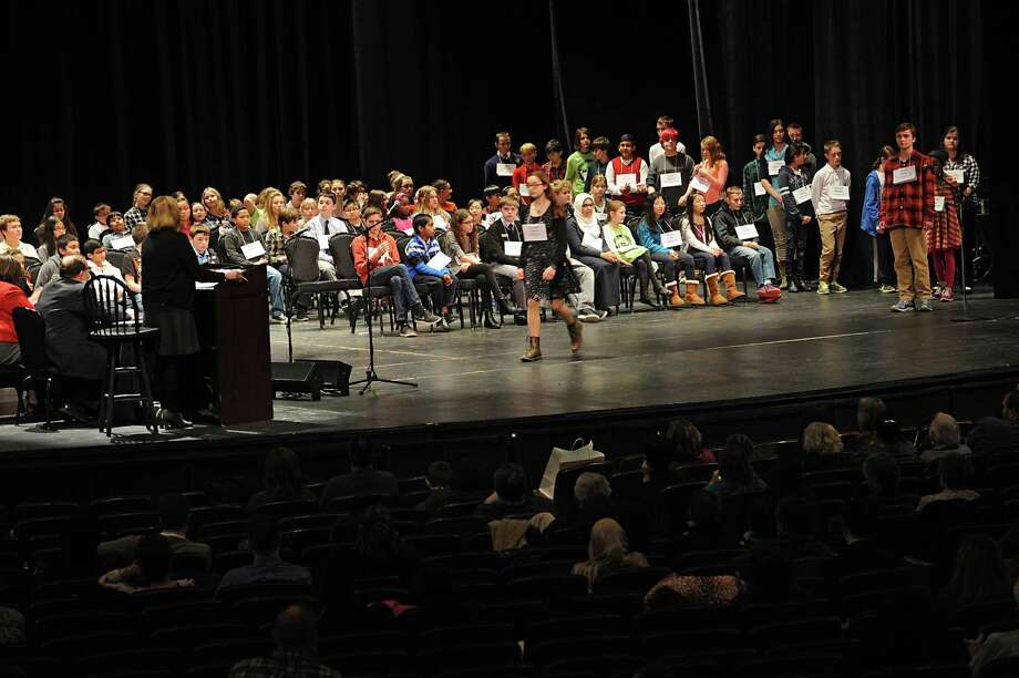 Red Hook eighth grader Alexandra Snyder walks across the stage toward the pronouncer and judges during the 34th Annual Capital Region Spelling Bee on Tuesday, Feb. 2, 2016 in Schenectady, N.Y.  (Lori Van Buren / Times Union) Photo: Lori Van Buren / 10034893A