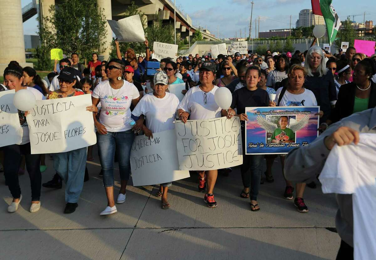 Family and friends lead a march for Josue Flores on Sunday, May 22, 2016, Houston.