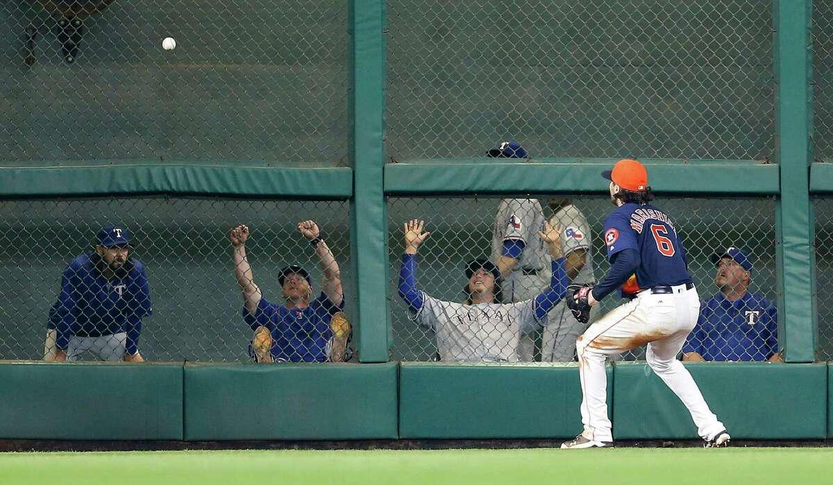 Houston Astros left fielder Jake Marisnick (6) chases Texas Rangers designated hitter Prince Fielder's double during the seventh inning of an MLB baseball game at Minute Maid Park, Sunday, May 22, 2016. ( Karen Warren / Houston Chronicle )