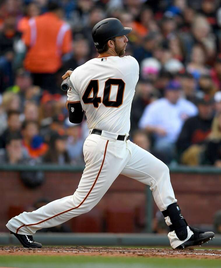 Madison Bumgarner #40 of the San Francisco Giants hits an rbi double scoring Gregor Blanco #7 against the Chicago Cubs in the bottom of the fifth inning at AT&T Park on May 22, 2016 in San Francisco, California. Photo: Thearon W. Henderson, Getty Images