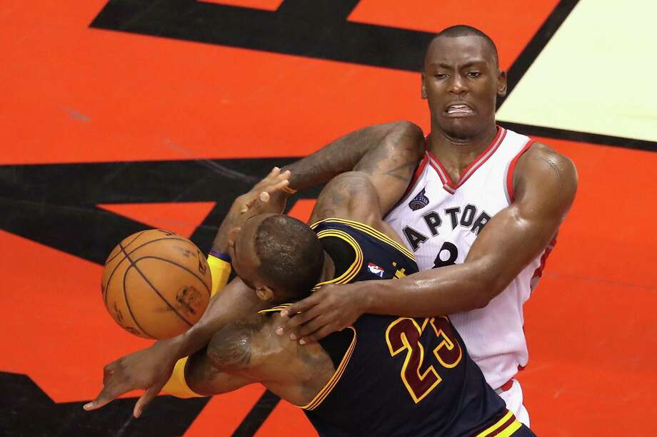 The Raptors-Cavaliers series has taken a physical turn, including Bismack Biyombo's flagrant foul on LeBron James during the fourth quarter of Toronto's Game 3 victory on Saturday night. Photo: Tom Szczerbowski, Stringer / 2016 Getty Images