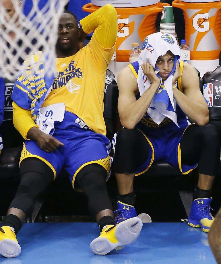 Golden State Warriors players Draymond Green, left and Stephen Curry watch action against the Oklahoma City Thunder during the second half in Game 3 of the NBA basketball Western Conference finals in Oklahoma City, Sunday, May 22, 2016. Oklahoma City won 133-105. (AP Photo/Sue Ogrocki) Photo: Sue Ogrocki, Associated Press