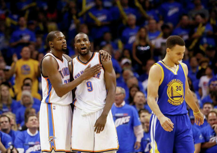The Thunder's Kevin Durant, left, and Serge Ibaka were too much for Stephen Curry and the Warriors. Photo: Sue Ogrocki, STF / AP2016