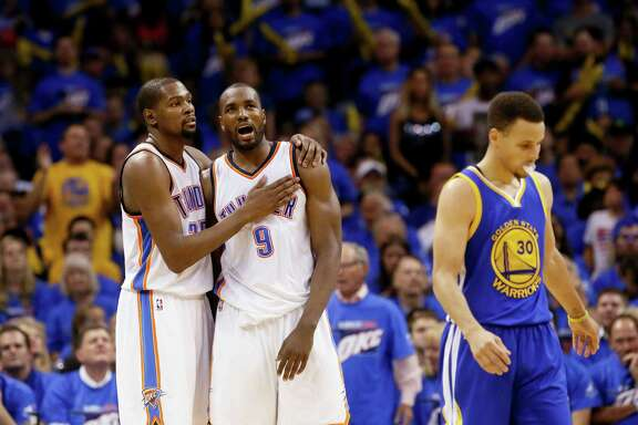 The Thunder's Kevin Durant, left, and Serge Ibaka were too much for Stephen Curry and the Warriors.