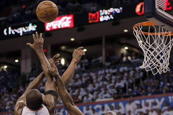 Draymond Green (23) is beaten to a rebound during the second half as the Golden State Warriors played the Oklahoma City Thunder in Game 3 of the Western Conference Finals  at Chesapeake Energy Arena in  Oklahoma City, Okla., on Sunday, May 22, 2016.