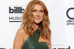 """FILE - In this May 17, 2015 file photo, Celine Dion poses at the Billboard Music Awards in Las Vegas. Dion will perform Queen's """"The Show Must Go On,"""" at the Billboard Music Awards on Sunday, May 22, 2016. (Photo by Eric Jamison/Invision/AP, File) ORG XMIT: NYET512"""