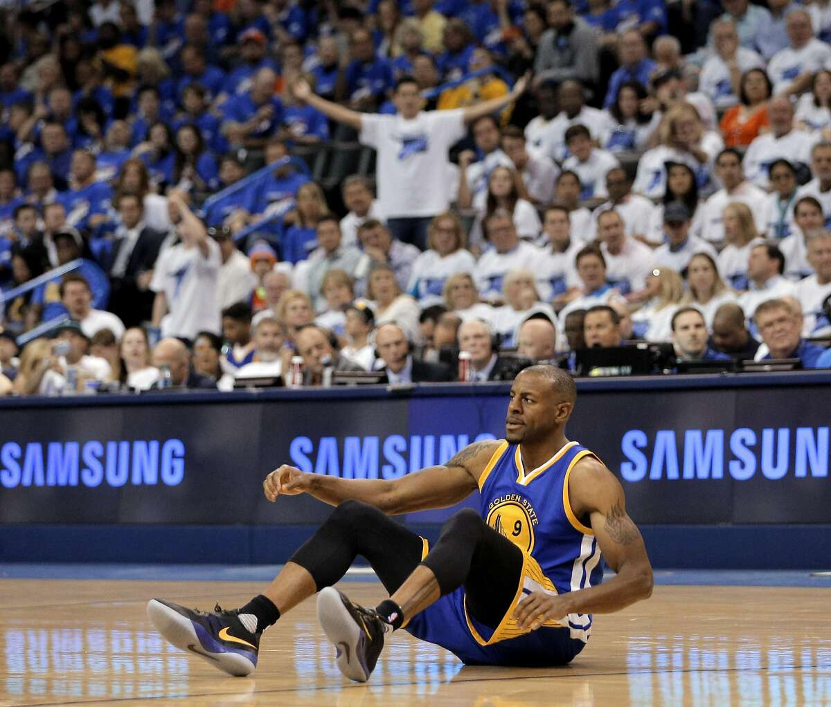 Andre Iguodala (9) sits on the floor after getting fouled during the second half as the Golden State Warriors played the Oklahoma City Thunder in Game 3 of the Western Conference Finals at Chesapeake Energy Arena in Oklahoma City, Okla., on Sunday, May 22, 2016.