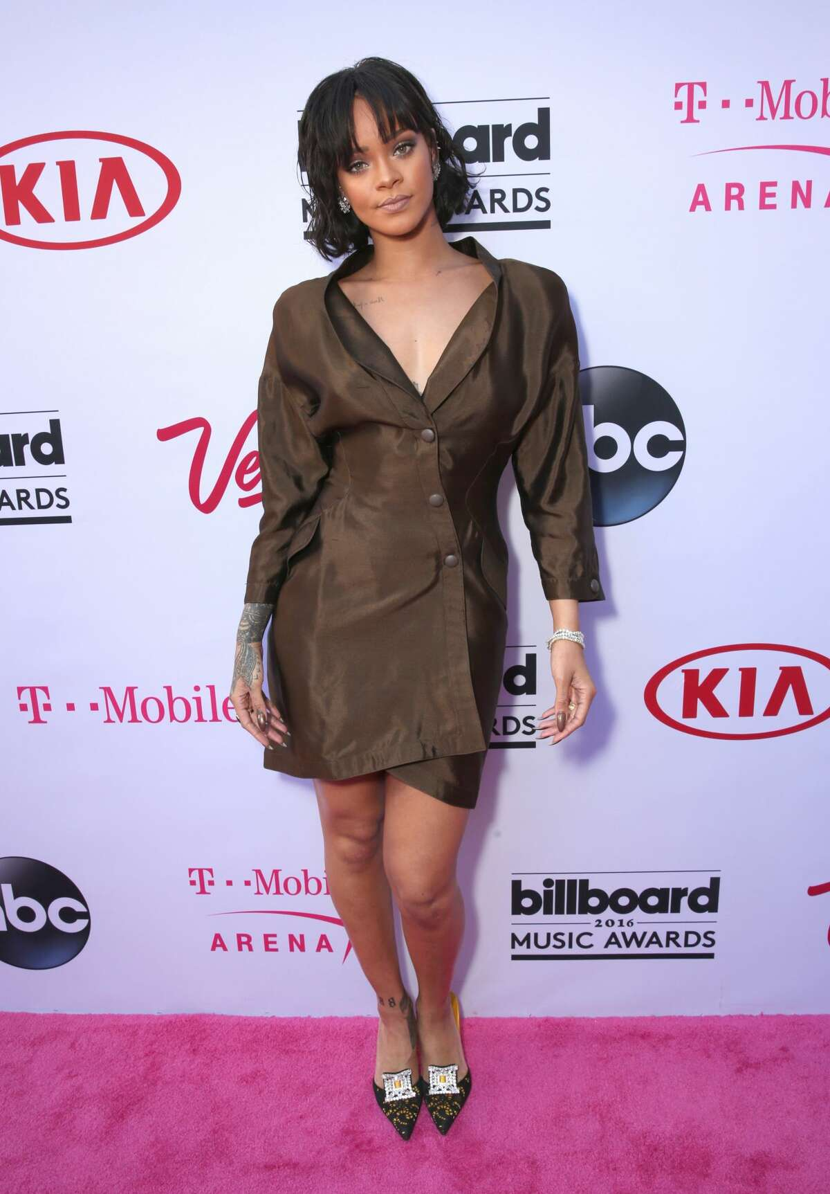 Worst: Rihanna Someone who markets umbrellas should have no need for a business-casual rain dress.