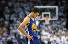 Stephen Curry (30) reacts to a possession call that went against the Warriors during the first half as the Golden State Warriors played the Oklahoma City Thunder in Game 3 of the Western Conference Finals  at Chesapeake Energy Arena in  Oklahoma City, Okla., on Sunday, May 22, 2016.