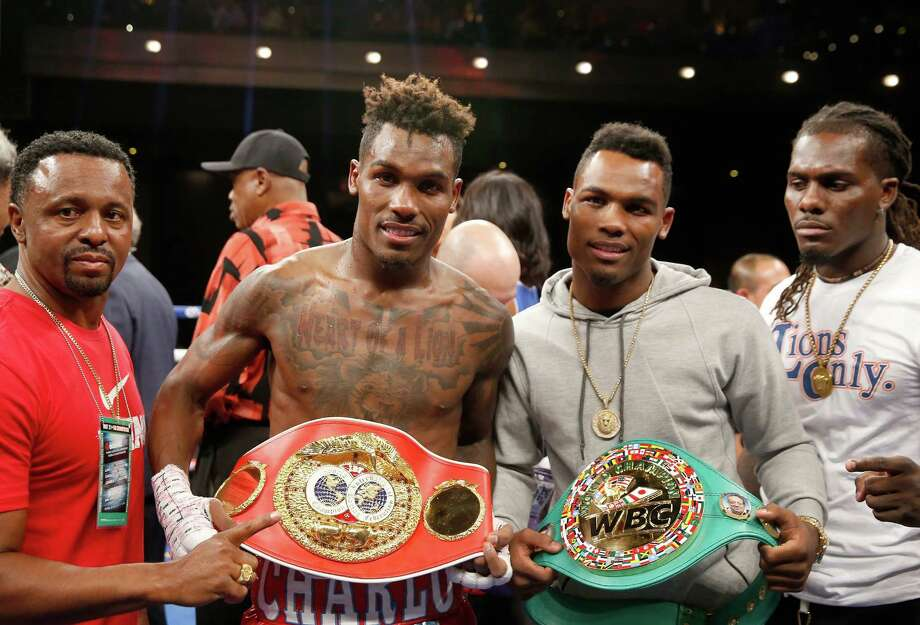 Jermail Charlo, left, and his twin brother Jermell picked up some gaudy and historic hardware Saturday night in Las Vegas. Photo: Steve Marcus, Stringer / 2016 Getty Images