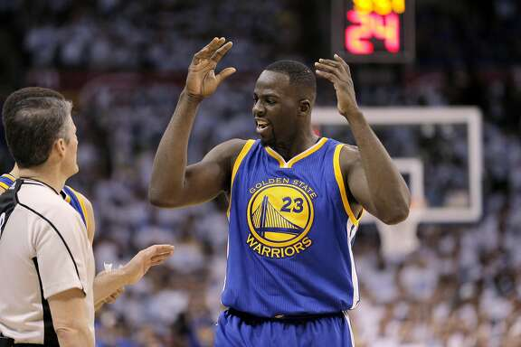 Draymond Green (23) discusses a flagrant 1, technical foul assessed to him with a referee during the first half as the Golden State Warriors played the Oklahoma City Thunder in Game 3 of the Western Conference Finals  at Chesapeake Energy Arena in  Oklahoma City, Okla., on Sunday, May 22, 2016.